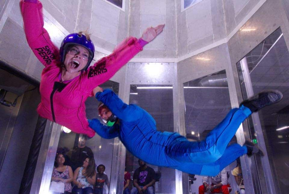 woman smiles indoor skydiving the first time near Orange County, CA